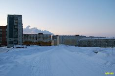 ...there's far north mining town of Norilsk.      The television station neighborhood in Norilsk,  Siberia, Russia    ----------                             A city in the arctic dessert. A city without a single tree. A polar oasis.