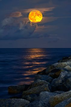 Full moon at sunset above the sea