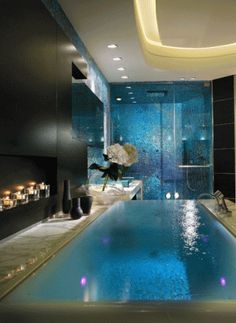this bathroom is like a dream. the tub is pretty much a pool. how cool is that?