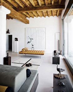 exposed natural timber beams to a clean-lined white washed contemporary room.