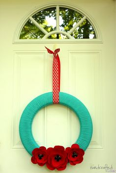 Summery Felt Poppy Yarn Wreath....loving red/turquoise combo right now