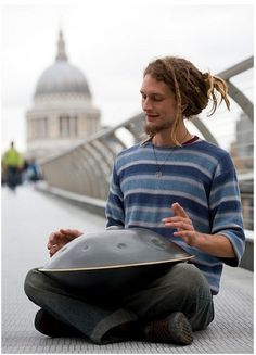 Daniel Waples....playing the Hang drum...I just found this photo being pinned and Its mine :) I took it a few years back and sent him a copy and now its reappearing from totally different places!