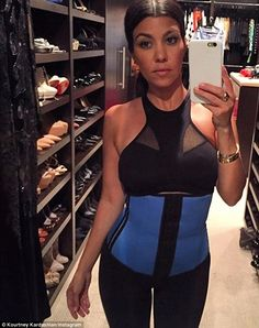 Trying it out: Kourtney Kardashian also shared an image of herself in the torso-tightening device in September
