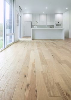 Bernina Hickory compliments any kitchen with a variety of tones from a timeless, light natural to a rich darker hue. | Bernina Hickory in Scalino #hardwood #floors #flooring #natural #kitchen #kitchendesign #hickory