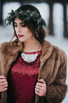 A snowy and moody winter woods styled shoot with a stunning red sequined dress by Britani Edwards Photography