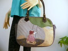 """SUN BONNET SUE ON SWING.  This carrier is for a 11"""" notebook."""