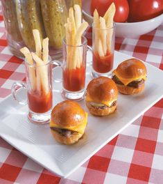 "Hamburger and fries are always a winning combo, and these little spuds and sliders put an adorably chic twist on the fast-food favorite. From kids to adults, who wouldn't love these mini ""fun bun"" burgers with a shot of french fries and ketchup on the side? They're the perfect way to serve a traditional favorite at a shower (or any occasion, really). Source: Pizzazzerie"