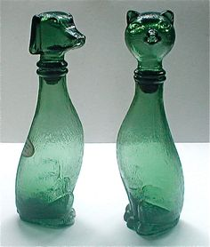 Green Glass Cat and Dog Decanter Bottles - Vintage 60s Kitsch Pup and Kitty Dachshund and Siamese by studiostebbylee on Etsy https://www.etsy.com/listing/158133499/green-glass-cat-and-dog-decanter-bottles