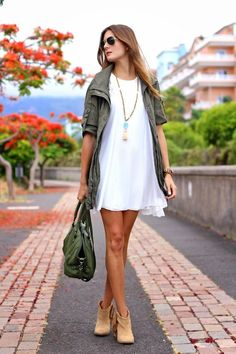 Loose white dress, camel ankle boots and military jacket. Love this look for fall.