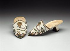 Pair of women's beaded mules  Sable, French, about 1794, Pair of women's mules. Tops of strung glass beads (called sablé) held together with looping stitches. Pink silk lining, leather soles. Top scene of balloon ascension, with two mounted, uniformed men in foreground, based on print depicting battle of Fleurus of 26 June 1794.