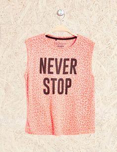 débardeur fitness never stop corail fluo Vetement Pas Cher Femme b68e828f7d5