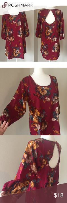 """Blouse Pretty red blouse with flower pattern and a sexy opening in the back. 100% polyester. The Medium measures 18-1/2"""" inches across the chest while laying flat; the XSmall measures 16-1/2"""" inches across the chest. (My mannequin is modeling the Medium) Rue 21 Tops Blouses"""