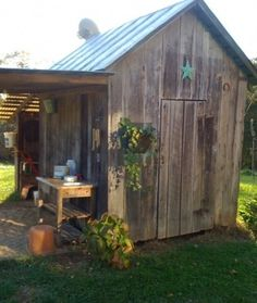 jf~I WILL HAVE A FENCED IN BACK YARD SO I CAN ENJOY SOMETHING LIKE THIS....more garden sheds!