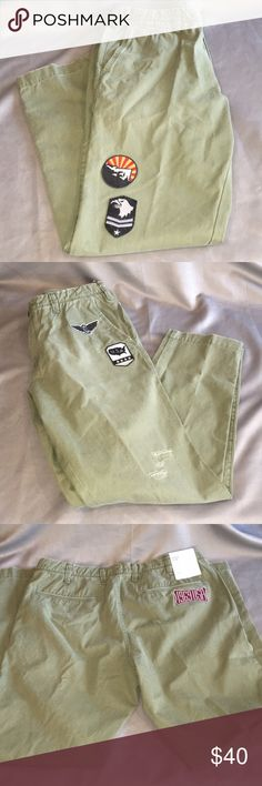 Gap NWT Army Green Patched Slim Khakis 36/32 NWT Army Green Gap Patched Slim Khakis 36/32. 4 patches on front and 1 patch in the back. Knee holes on the left leg are purposely there. They measure approx 11.5 rise and 32 inch inseam. Checkout my other listings and add to a bundle to save!  Green Patched Slim Khakis 36/32 by Gap NWT. GAP Pants Chinos & Khakis