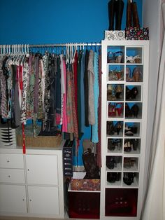 Shoe storage by IKEA. Unfortunately, I think I have too many shoes for this, but I like how tidy it is. (Also, love the blue closet!)