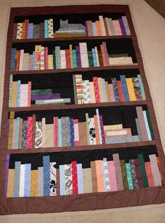 Bookshelf quilt with a kitty!