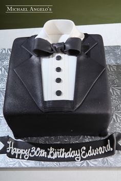 Black Tie Profession #166Hobbies by Michael Angelo's Bakery | This cake is covered in fondant and decorated like a tuxedo with a bow tie.
