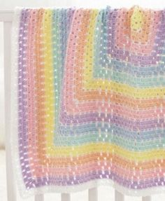 Make a pastel rainbow crochet afghan. This Beginner Daydream Baby Blanket is perfect for your little one.