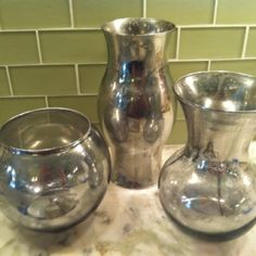 Made my own mercury glass with Krylon Looking Glass spray paint and thrift store vases!!!