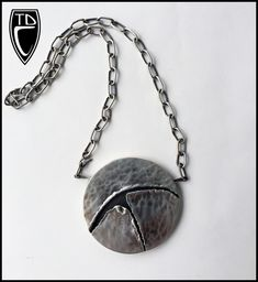 """Todd Conover, Hollow Formed """"Torn"""" Pendant and Chain, 2014, patinated sterling silver, copper"""
