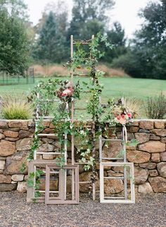 Ceremony decor on old ladders with vintage frames grown and designed by Love 'n Fresh Flowers.
