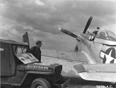 How's your radio? Photo: Ground crew made an 'on the line' check of the radio in the P-51 Mustang 'Hot Shot Charlies' of the 364th Fighter …