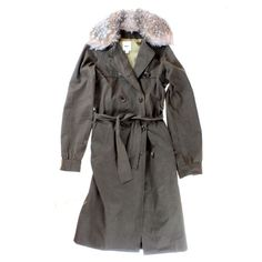 This long Whit trench coat is show in green and is perfect for Fall and winter weather, both rain and shine. Features faux fur lining and belt along waist. The WHIT coat is shown with a Rag and Bone Ivory Harlow Dress and Isabel Marant pumps.
