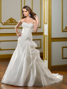 Style# B1384 Visit Vera's House of Bridal in Madison, Wisconsin to try on this and similar dresses today! For specific dresses please call ahead, as our inventory changes daily!