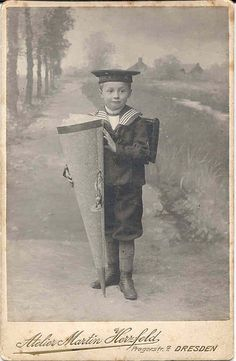 German schoolboy with school cone in a sailor suit