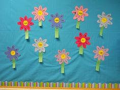 flower bulletin board, May flower crafts, May bulletin board Flower Crafts, Flower Art, Flower Bulletin Boards, Spring Words, Abc Phonics, Family Flowers, Classroom Walls, Tissue Paper Flowers, Spring Theme