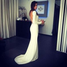 A simple long sleeve backless wedding dress. This is just perfect!