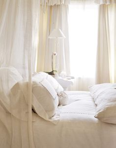 White bedding + canopy.