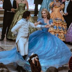 Cinderella in her gorgeous dress is dancing with Prince Kit ♥ (Lily James and Richard Madden) Credit to instagram @cream0306