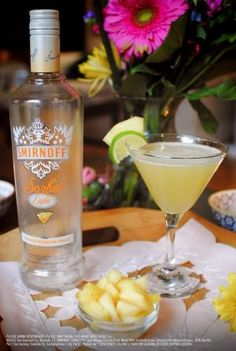 Tropical Martini Drink Recipe: 1.5 oz SMIRNOFF SORBET™ Light Mango Passion Fruit, 1.5 oz coconut water, 1 oz pineapple juice. Combine ingredients in a cocktail shaker, add ice, shake and strain into a chilled martini glass. Garnish with pineapple and/or lime wedge. #Smirnoff #vodka #drinkrecipe #mango #spring by tinahart