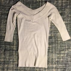 Cream sweater This sweater can go off the shoulder. There is some pilling around the armpit area. The sleeves are 3/4 Urban behavior  Sweaters