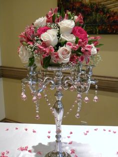 Silver candelabra centerpiece  Floral arrangements and decor provide from Scent of Flowers Photo by Julia Nutu - Owner of Scent of Flowers