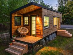 Tiny timber clad portable house on wheels with small deck and twin set of steps. Source www.countryliving.com