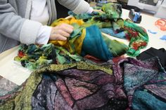 "Portland fiber artist Maris Cavanaugh, in collaboration with ""Beswarmed"" artist Karin Graves, working with the fabric in design phase for my new coat."