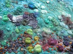 Briny Another sea inspired textile art piece with lots of texture, french knots and seed stitches. Those aqua blues work well with lime green and plum, I think, and the gold knots lift it. There is also some hand dyed paper textures on there too