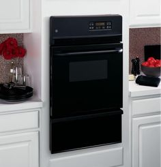 "JGRP20BEJBB in Black On Black by GE Appliances in Norwich, CT - GE® 24"" Built-In Gas Oven"