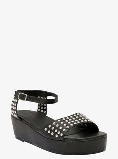These faux leather black platform sandals have silver tone studs across the toe and side with an ankle strap.