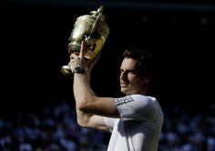 Andy Murray celebrates with the Wimbledon trophy. Photo: AP Photo/Anja Niedringhaus, Pool