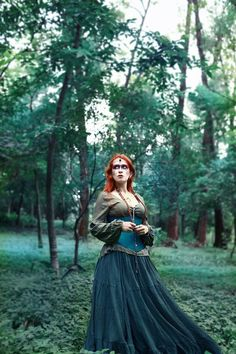 Dhy Ngetal by Rafael Ohana - viking - floki - celtic - warrior - woman - corset - redhead - green - forest - folk - boho