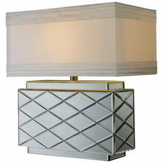"""Mirrored table lamp with a cream shade.     Product: Table lamp    Construction Material: Mirrored glass and metal    Color: Cream and silver   Features: 3-Way switch Accommodates: (1) 100 Watt medium base bulb - not included    Dimensions: 20"""" H x 16"""" W"""