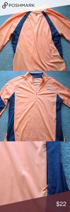 Avia quarter zip Bright orange with a charcoal gray accent on the sides and some of the sleeves. Zipper pocket on the bottom front left of the quarter zip Avia Tops Sweatshirts & Hoodies