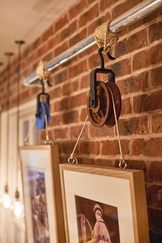 Wheel and Pulley hanging picture frame detail with scaffolding metal poles and tethered rope. Quirky way to display wall art. Bar & Restaurant Design by Tibbatts Abel. Saint Paul's House. www.tibbattsabel.com