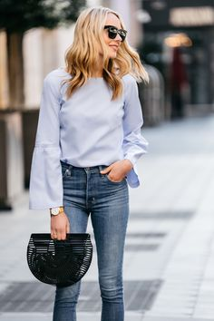 Fashion Jackson, Street Style, Blue Bell Sleeve Top, Levi's Mile High Skinny Jeans, Cult Gaia Black Acrylic Ark Clutch