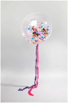 This is the perfect example of what to include at your modern indoor reception. Personalize it with your own wedding colors and place them around the dance floor! | Balloons: BonBon | See more confetti wedding details here: http://www.mywedding.com/articles/confetti-wedding-details/