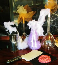 """The Mad Scientist's Lab! To make this cute display we used a vintage beaker set, tulle, and puffed out spider web fluff for the smoke! It's Alive!    """"Like"""" us on Facebook! : http://www.facebook.com/CourtofTwoSistersandTheUpperCourt    #halloween #crafts #diy #science"""