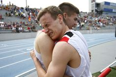 Cedar Falls' Hunter Lavallee, left, and Zach Shippy embrace after winning the 4A 4x400 meter relay at the state track meet.